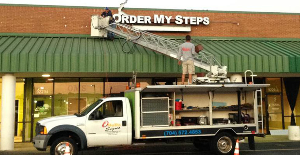 channel-letter-repair-truck-hello-signs.