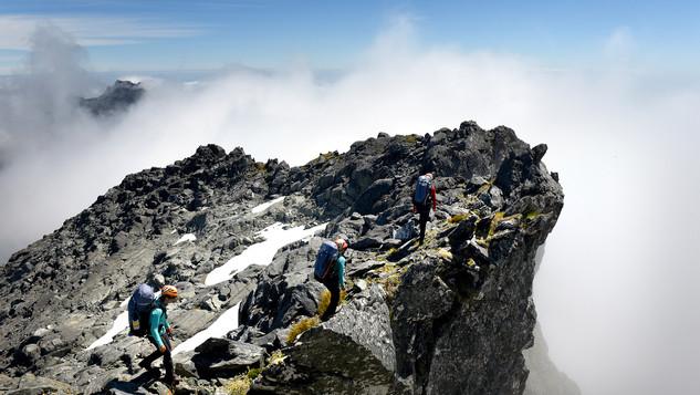 Rosie_Liz_Ana_traversing_unexplored_peak