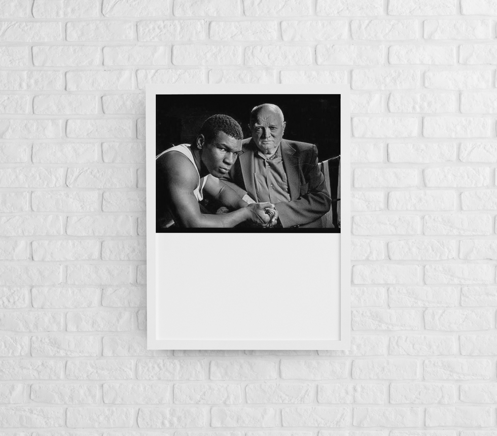 mockup-of-a-framed-art-print-hanging-on-a-brick-wall-m964 (11).png