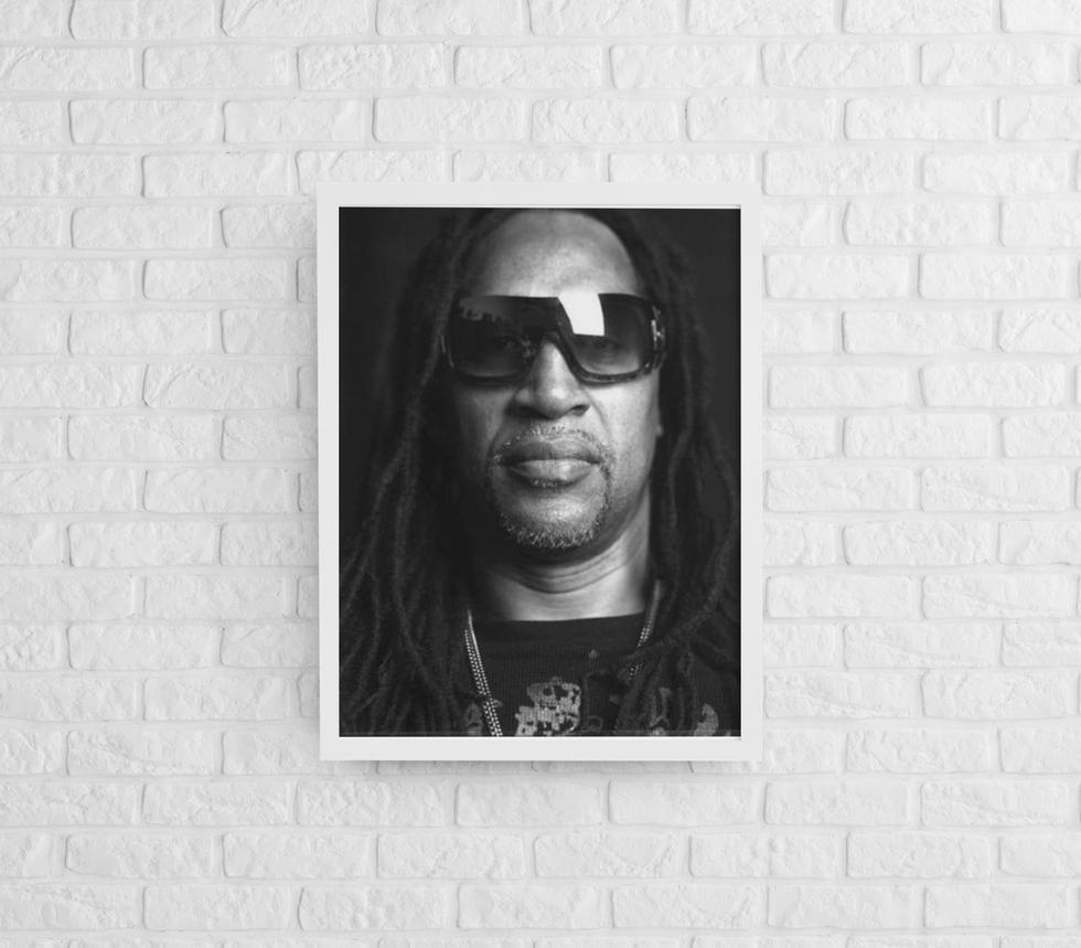 mockup-of-a-framed-art-print-hanging-on-a-brick-wall-m964 (17).png