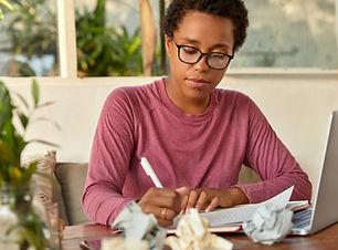 serious-dark-skinned-woman-copywriter-writes-in-sh-2021-04-06-15-37-43-utc.jpg