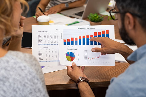 business-people-analyzing-graphs-2021-04-02-18-57-52-utc.jpg