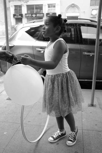 Girl with Balloon & Hular Hoop. New York City, 2016