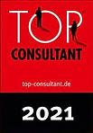 tc_21_leistungen_qualitaetssiegel_Logo_vor_glitzerndem_Hintergrund (1).jpg