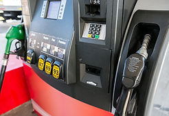 Gas pump close up with nozzle in foregro