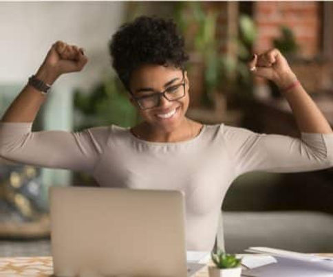 black-woman-looking-at-monitor-happily-w