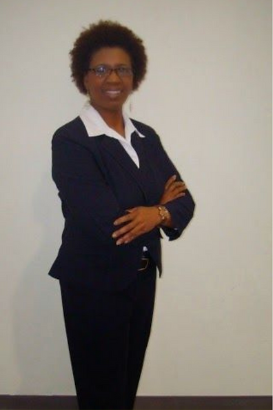Website Jackie Capers Brown standing wit