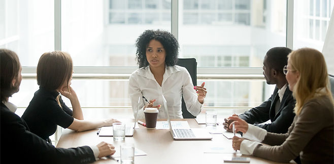 black female boss leading meeting use th