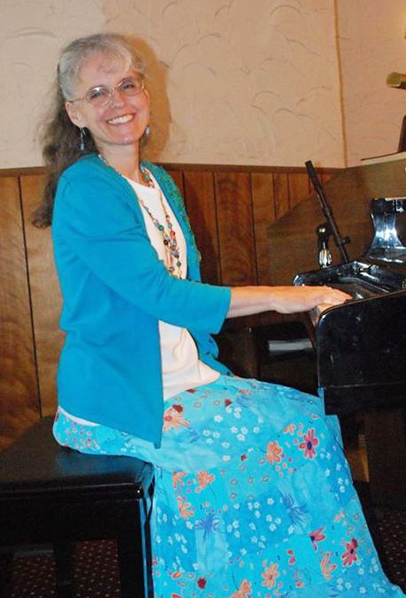 Kim playing piano at church