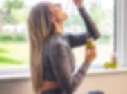 woman taking her cbd drops