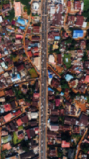 aerial-photography-of-road-between-house