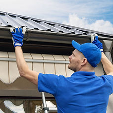 roofer-working-with-gutters.jpg