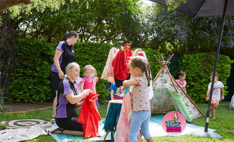 TG's Childcare Kindergarten Children Playing with Educators Outdoors