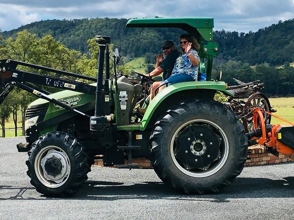 David and Chrissy on tractor ready for clean up, Pappinbarra farm, Chrissy's residence, Flood stories, NSW March 2021, feature story by Brilliant-Online