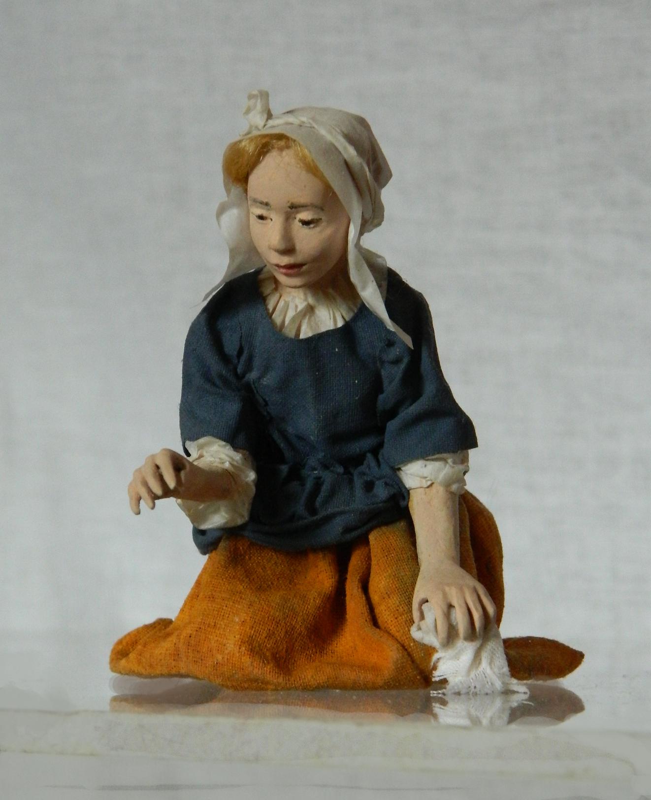 Kneeling maid