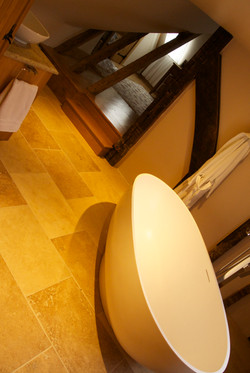 Oak work with solid stone bath