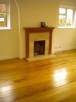 Oak floor fitted round fire place