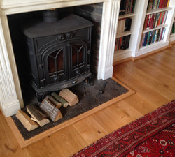 Solid oak trim round fire place