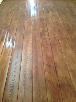 Stained oak worn effect flooring