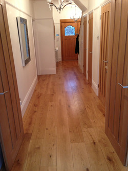 Continuous oak floor into hall