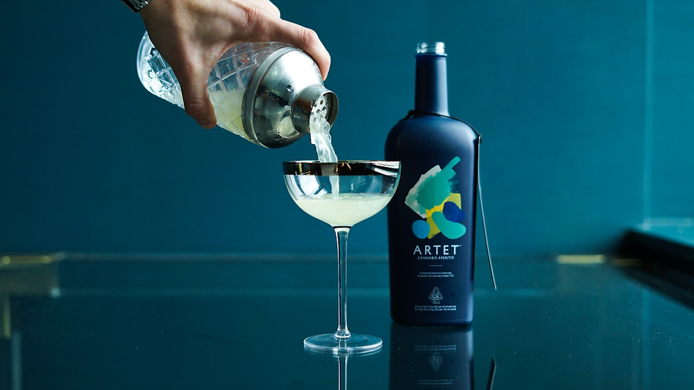 Pouring a glass of Arnet into  modern martini glass