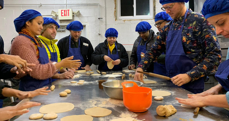Participants of a retreat making chapatis