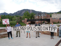 Protest to vote NO on TPP at Boulder Democratic Party Truman Dinner