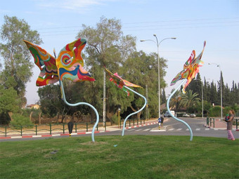 Three butterfly figures