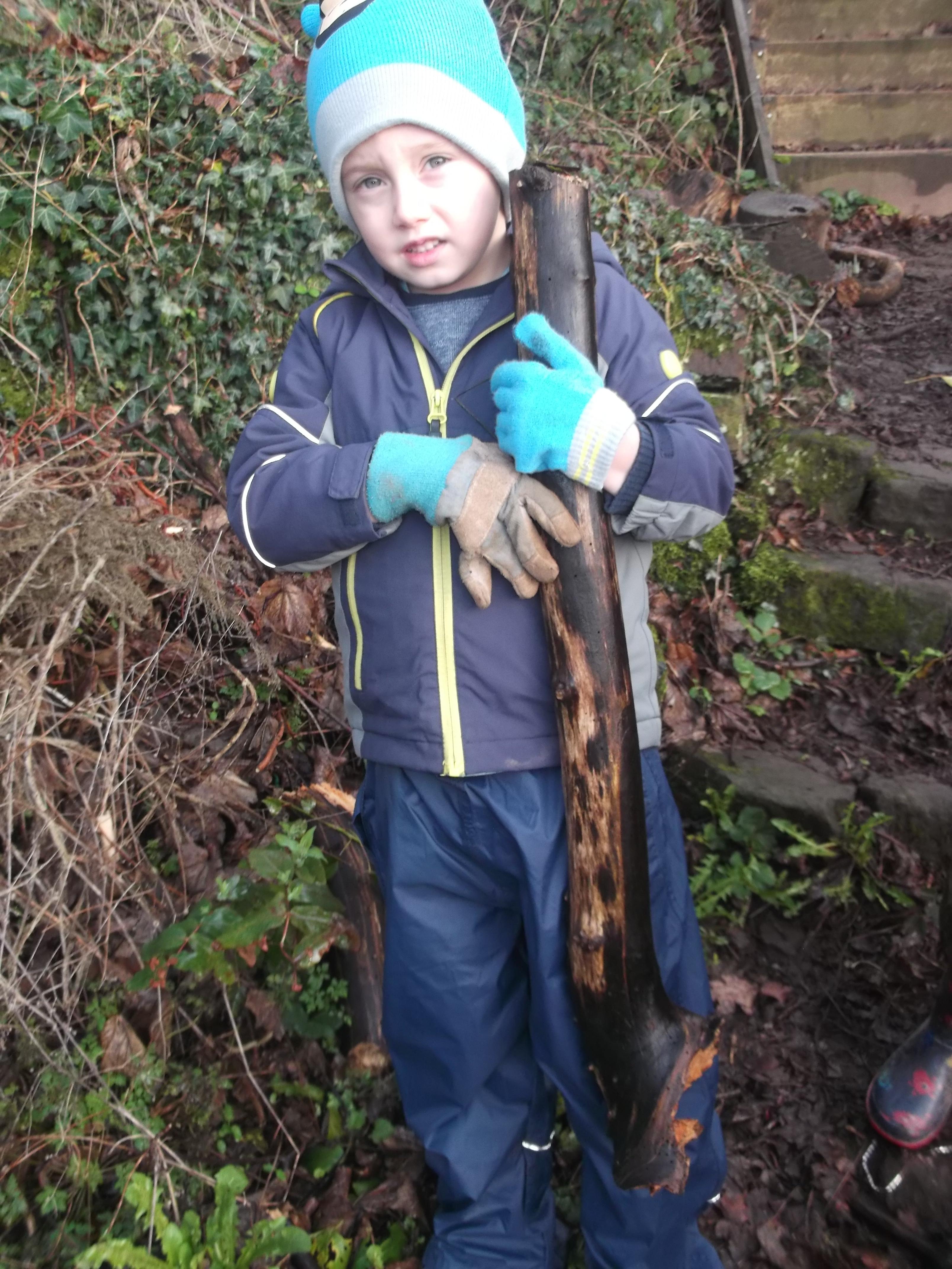 Infants working on the allotment