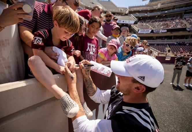 Johnny Signing Kids Hand.jpg
