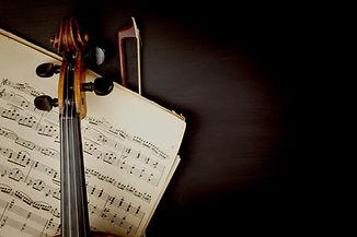 Violin over Sheet Music
