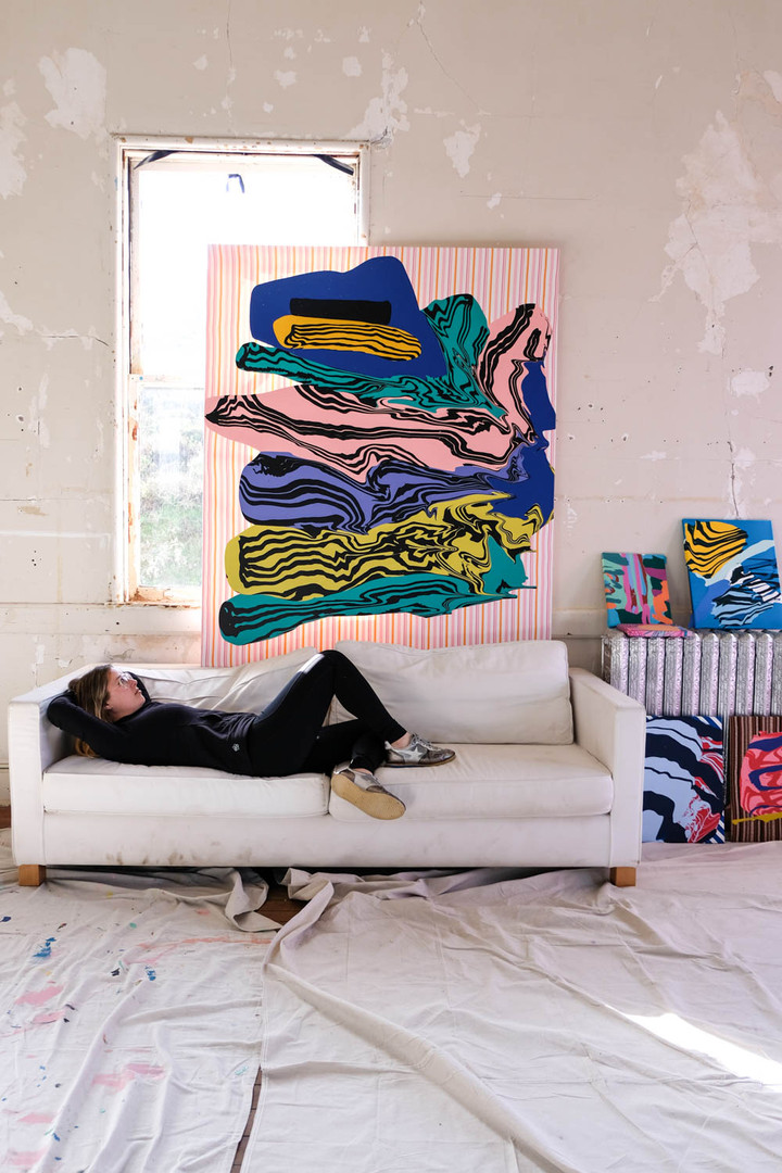 Jenny Sharaf with her paintings photo credit: Megan O'sullivan