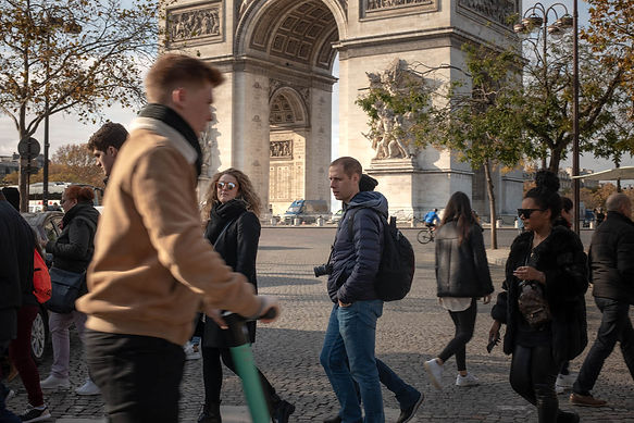 Alexa walking by the Arc de Triomphe