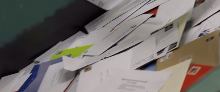 A lawn care guy went to put mail back in a mailbox. He took out 39 checks worth $171,000