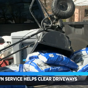 Lawn care service helps elderly customers remove snow from driveways