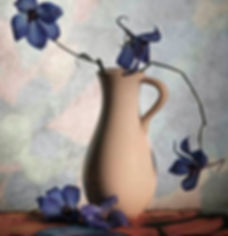 Photograph of vase with blue orchids