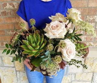 A unique arrangement featuring succulent