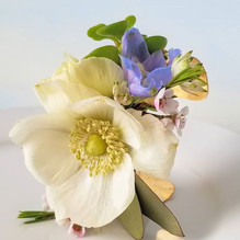 Spring corsage with anemone, delphinium