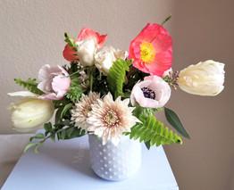Spring Arrangement. Tulips, poppies, ane