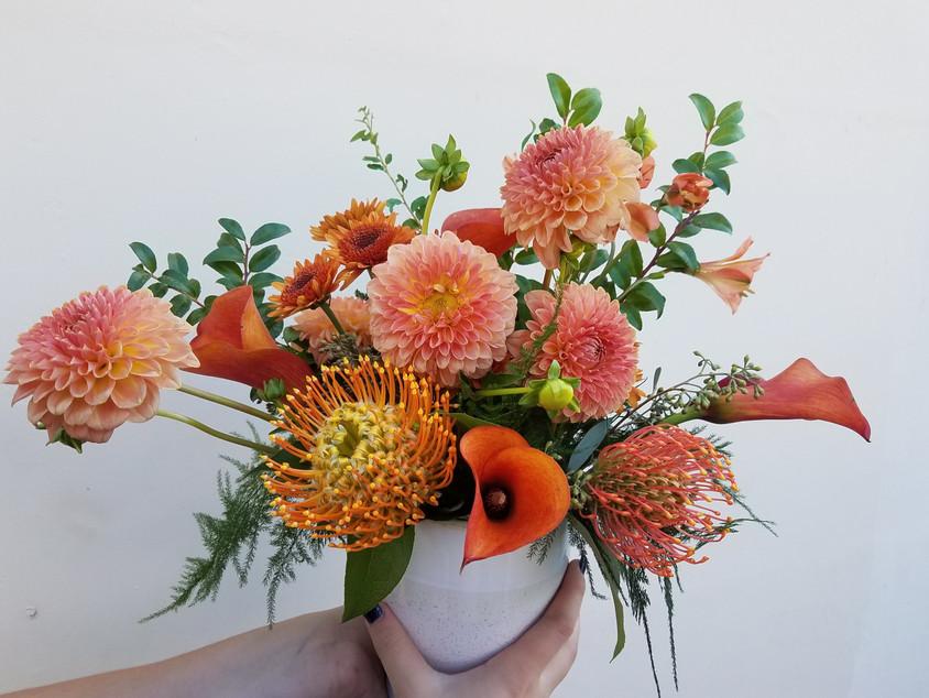 Orange arrangement. Dahlias, pincushion