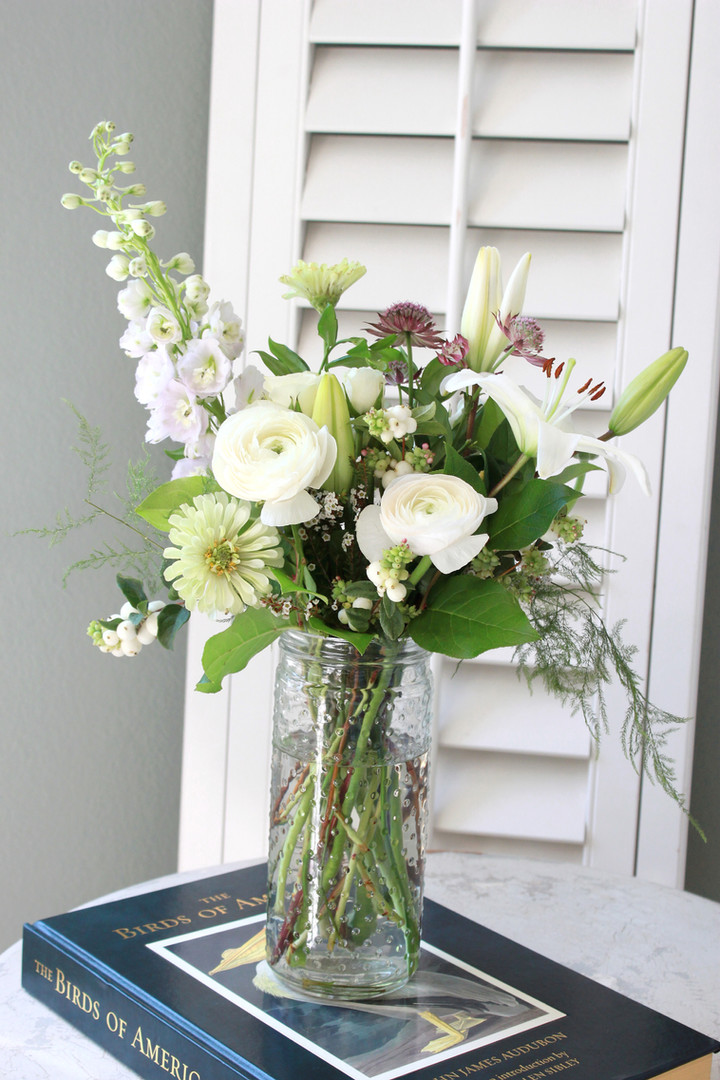 Tall white arrangement.  ranunculus, zin