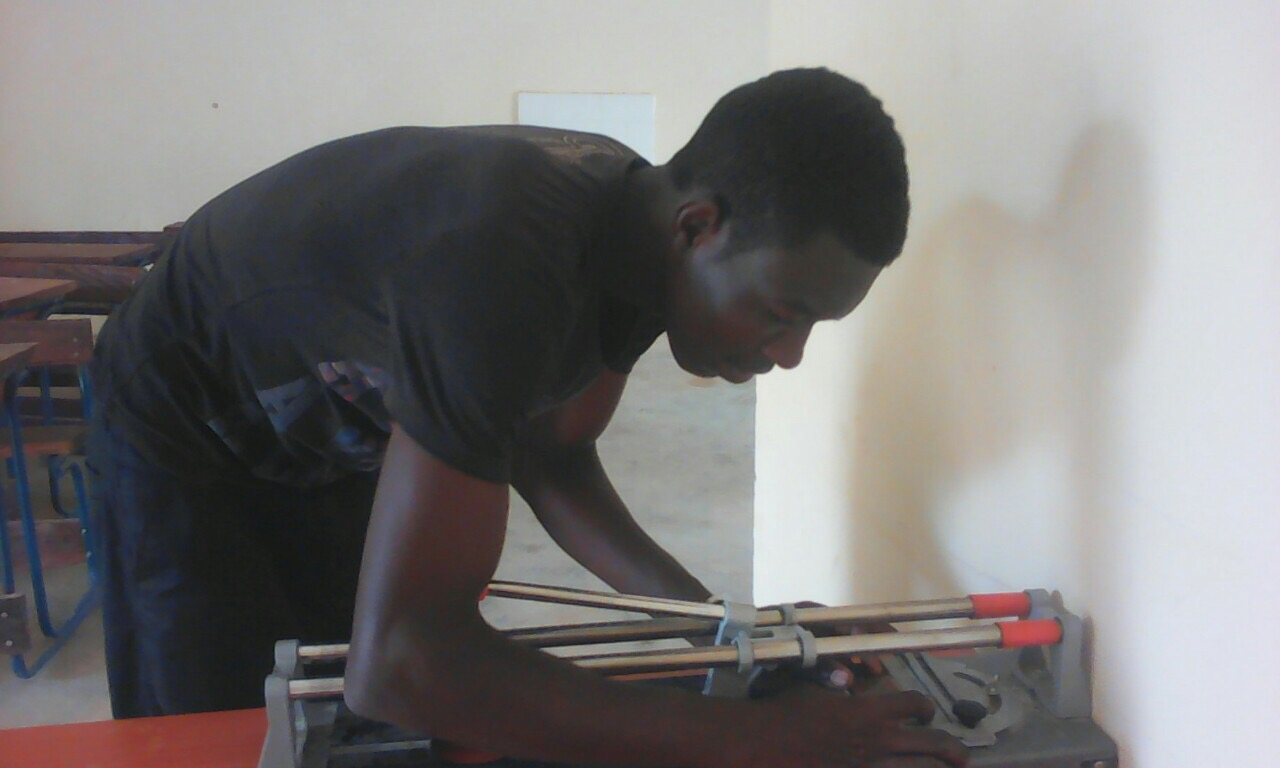 young man doing tile work