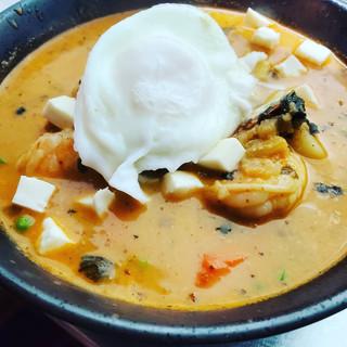 Chupe de Camarones. Shrimp, panca, ají amarillo, rice, poached egg,  queso fresco, huacatay, corn, potato, zapallo, splash of milk.