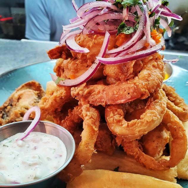 Jalea de Mariscos. Crispy fried seafood platter. Fish, mussels, shrimp, calamar, fried yuca. Salsa criolla, tartar sauce, ají amarillo.