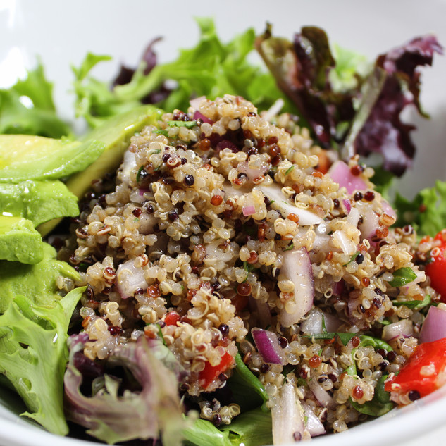 Quinoa Salad. Red and white quinoa, red bell peppers, mixed greens, onions.  EVOO-red wine vinaigrette
