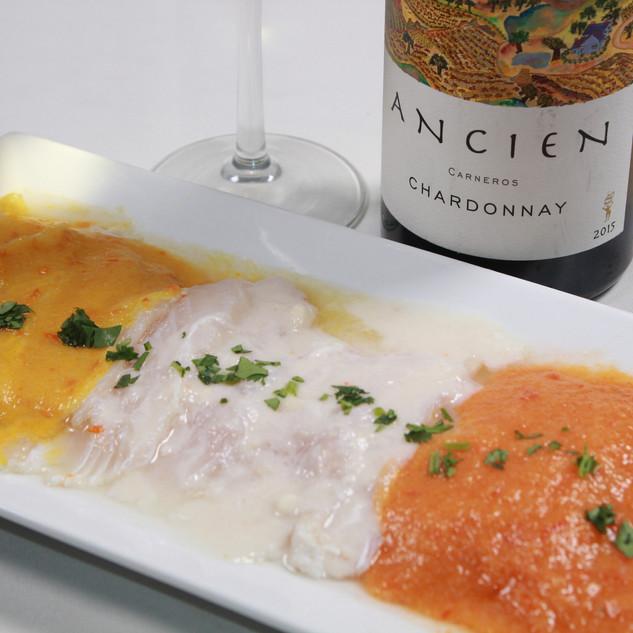 Tiradito Tres Salsas. Thinly sliced white fish, classic leche de tigre, ají amarillo and rocoto.