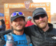 Don Reichelt an Leo Lesperance at the finish line of a 50 mile ultramarathon