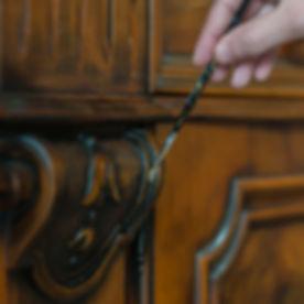 Hand restoring a wood furniture.jpg