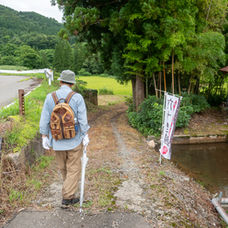 4. Follow the narrow path near a house.