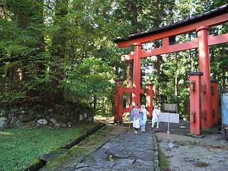 "Cross the torii. That's it, you're at the top of Mt. Haguro! Otsukaresama deshita お疲れ様でした (""Congratulations for your efforts"")"